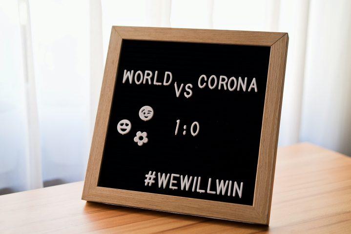 world vs corona sign wewillwin