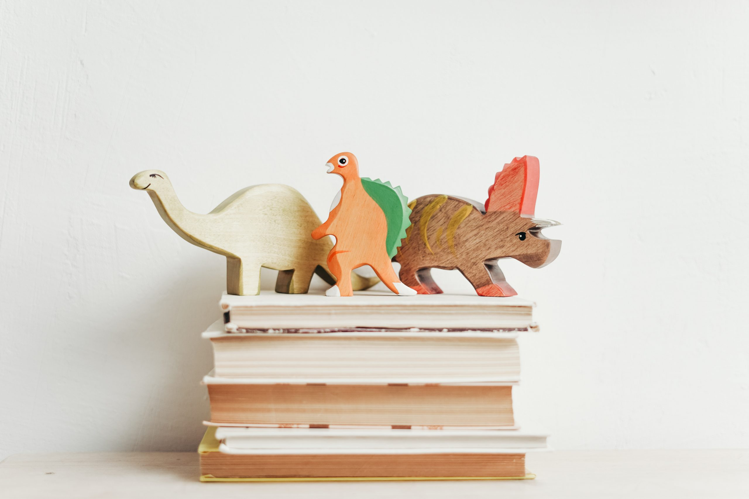 books with wooden dinosaurs