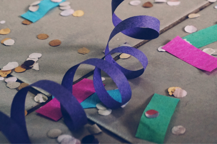 paper decorations and confetti on the floor