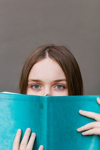 girl looking over a book