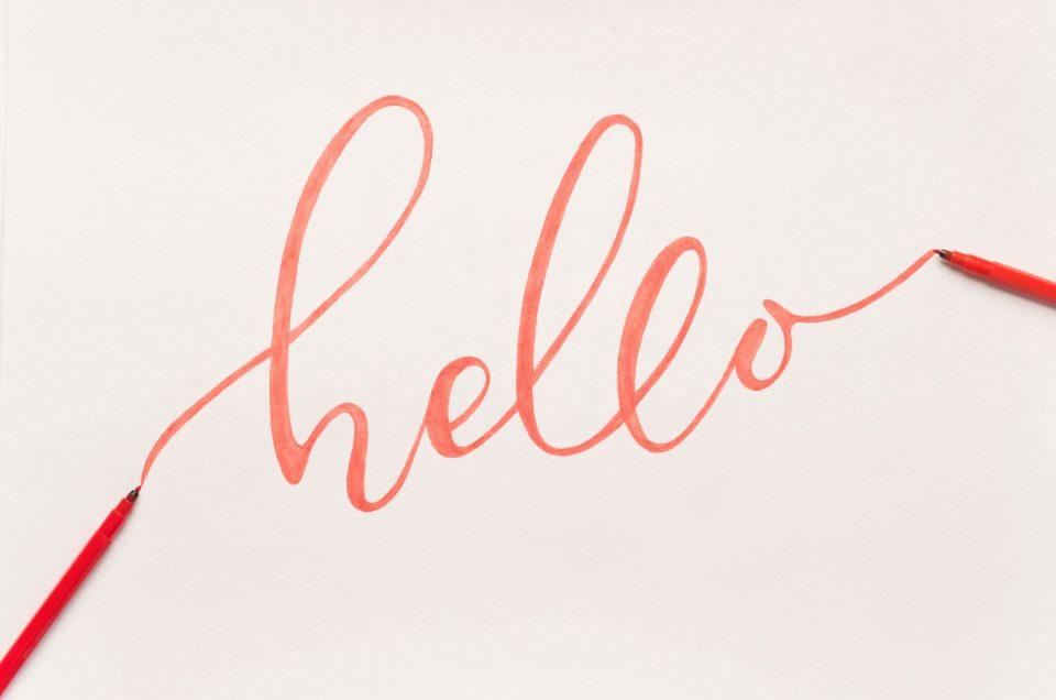 hand written orange hello